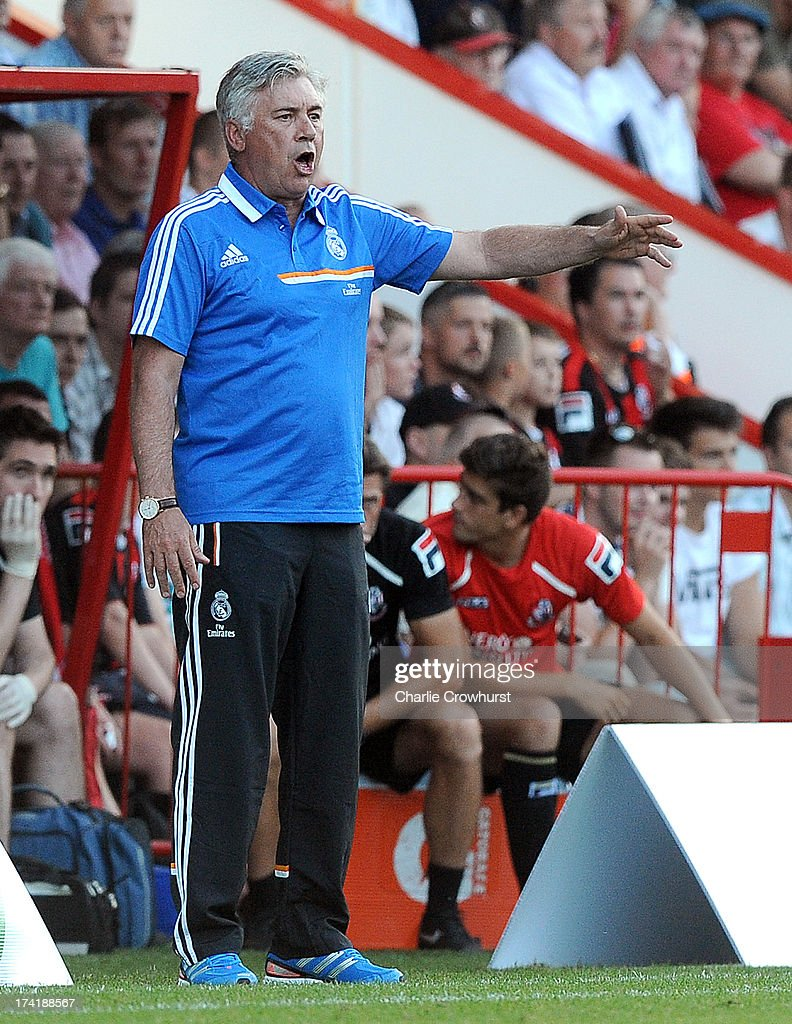 Real Madrid manager Carlo Ancelotti gives orders out to the team during the pre season friendly match between Bournemouth and Real Madrid at Goldsands Stadium on July 21, 2013 in Bournemouth, England,