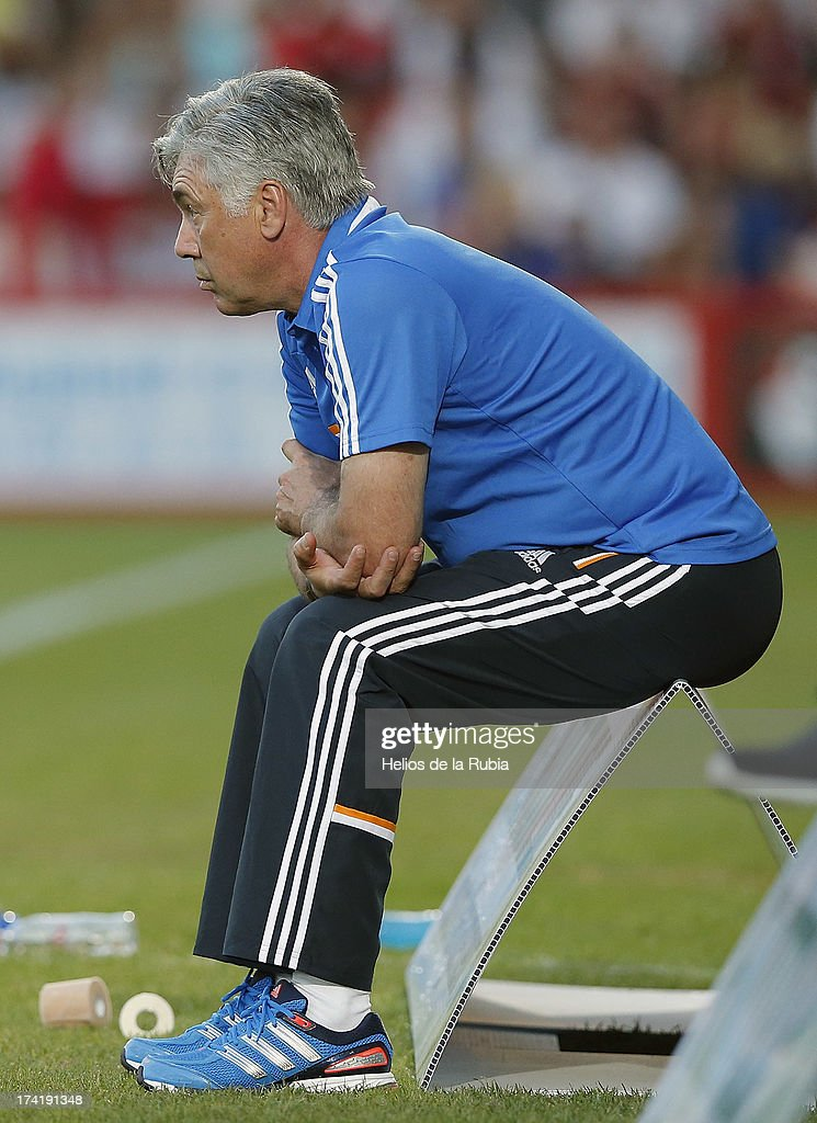 Real Madrid manager Carlo Ancelotti looks on during the pre season friendly match between Bournemouth and Real Madrid at Goldsands Stadium on July 21, 2013 in Bournemouth, England.