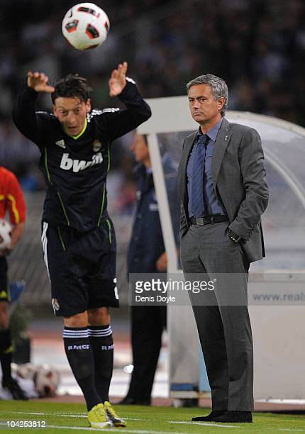 Real Madrid manager Jose Mourinho watches Real's Mesut Ozil take a throw in during the La Liga match between Real Sociedad and Real Madrid at Estadio...