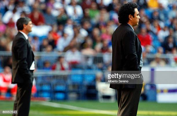 Real Madrid manager Juande Ramos and Almeria manager Hugo Sanchez look on during the Primera Liga match between Real Madrid and UD Almeria at the...