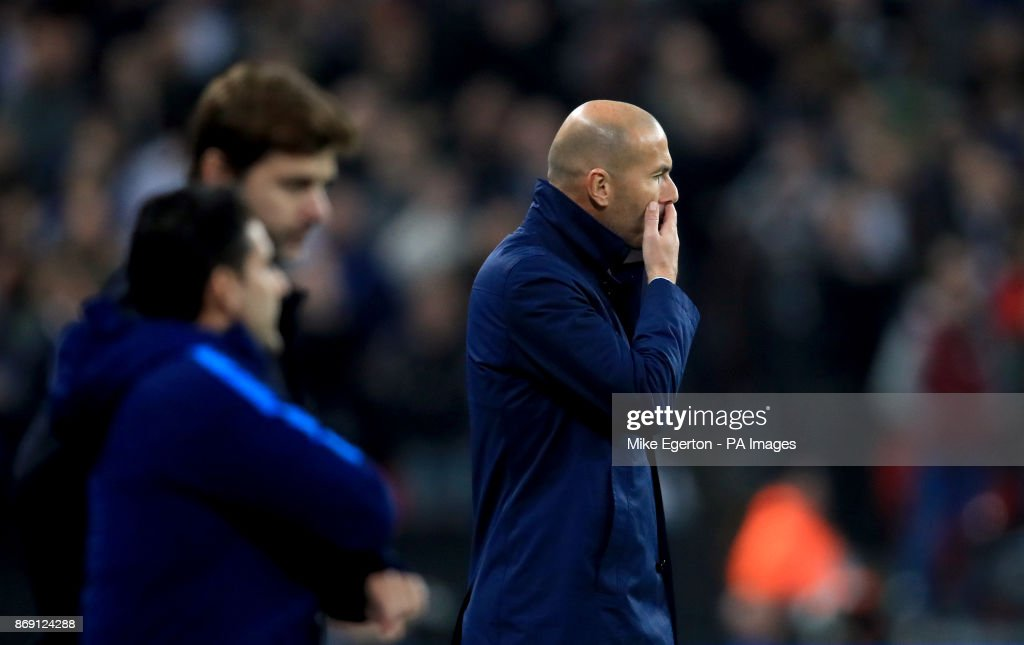 Real Madrid manager Zinedine Zidane (right) and Tottenham Hotspur manager Mauricio Pochettino (second left) during the UEFA Champions League, Group H match at Wembley Stadium, London.