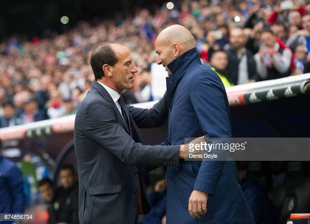 Real Madrid manager Zinedine Zidane greets manager Salvador Gonzalez Marco VoroÕ of Valencia CF before the start of the La Liga match between Real...