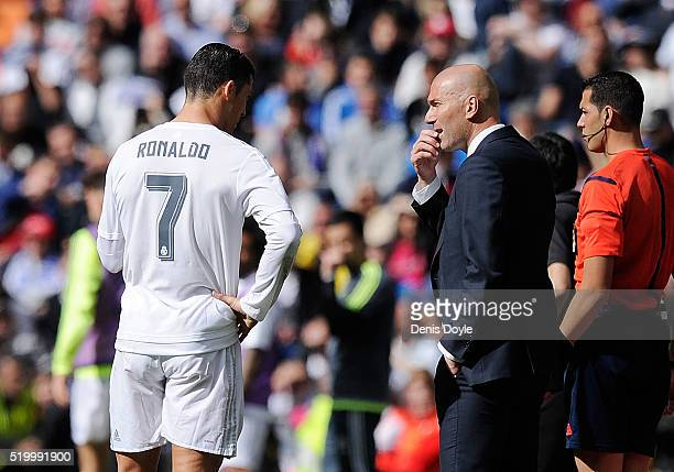 Real Madrid manager Zinedine Zidane has a word with Cristiano Ronaldo of Real Madrid during the La Liga match between Real Madrid and Eibar at...
