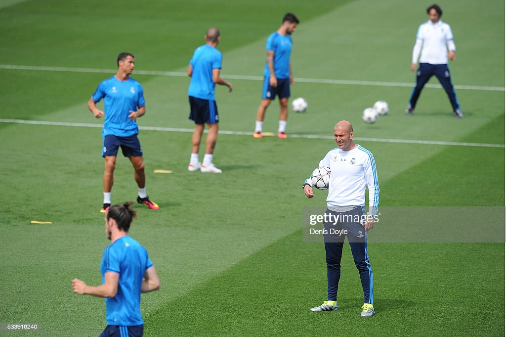 Real Madrid manager Zinedine Zidane looks over the team training session during the Real Madrid Open Media Day ahead of the UEFA Champions League Final against Club Atletico Madrid at Valdebebas training ground on May 24, 2016 in Madrid, Spain.