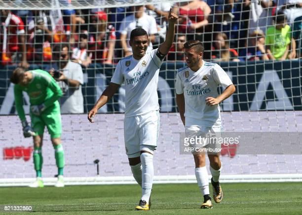 Real Madrid midfielder Carolos Henrique Casemiro celebrates after scoring a goal on Manchester United goal keeper David De Gea on a penalty kick...
