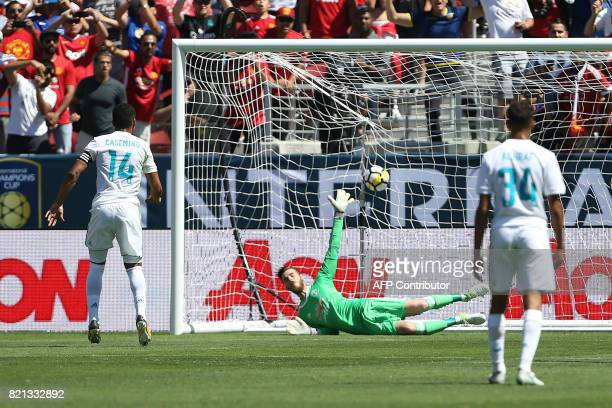 Real Madrid midfielder Carolos Henrique Casemiro scores a goal on Manchester United goal keeper David De Gea on a penalty kick during the second half...