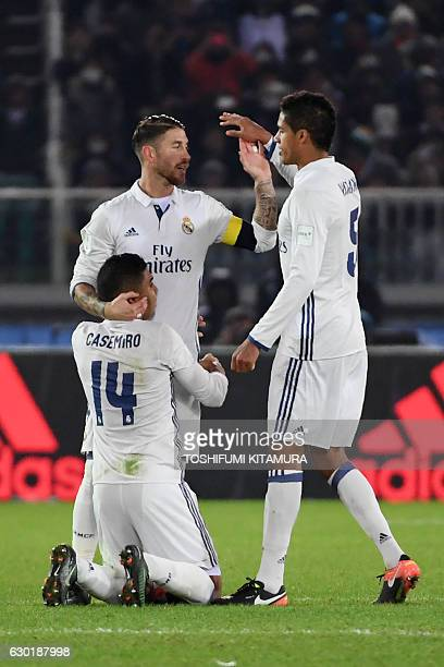 Real Madrid midfielder Casemiro defender Sergio Ramos and defender Raphael Varane celebrate a goal during extratime of the Club World Cup football...