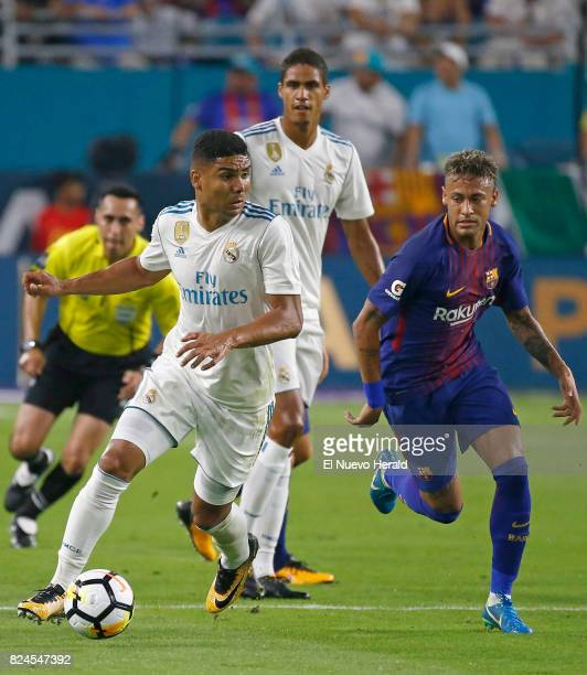 Real Madrid midfielder Casemiro vies with Barcelona forward Neyma during the first half of the ''El Clasico Miami'' BarcelonaReal Madrid match as...