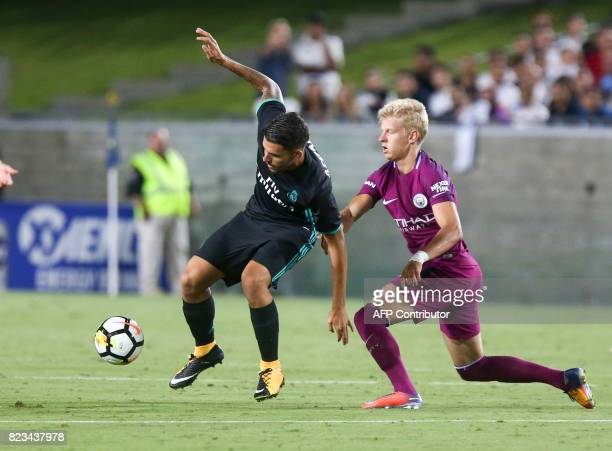 Real Madrid midfielder Dani Ceballos left and Manchester City midfielder Oleksandr Zinchenko vie the ball during the second half of the International...