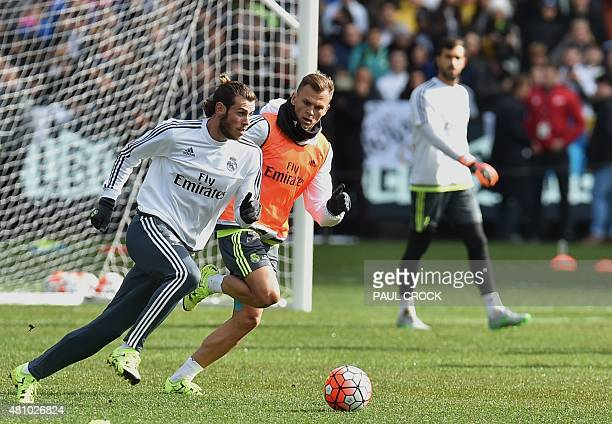 Real Madrid midfielder Gareth Bale prepares to run with the ball during a team training session ahead of the International Champions Cup football...