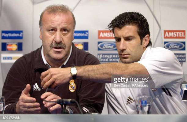 Real Madrid midfielder Luis Figo helps coach Vixente Del Bosque with his microphone during a press conference at Hampden Park stadium Glasgow Real...