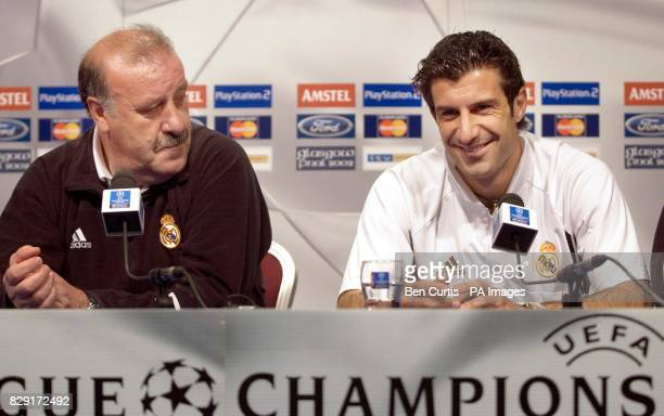Real Madrid midfielder Luis Figo with coach Vixente Del Bosque during a press conference at Hampden Park stadium Real Madrid play Bayern Leverkusen...