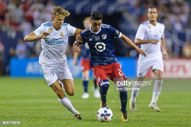 Real Madrid midfielder Marcos Llorente and MLS AllStar and Atlanta United FC Midfielder Miguel Almiron battle for the ball in the second half during...
