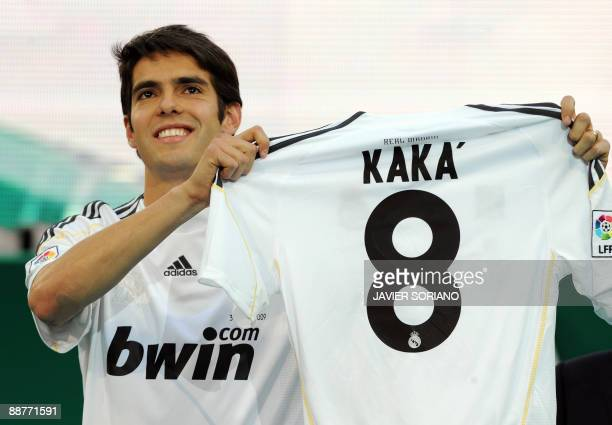 Real Madrid new player Brazilian midfielder Kaka shows his Real Madrid new jersey number 8 during his official presentation on June 30 2009 at the...