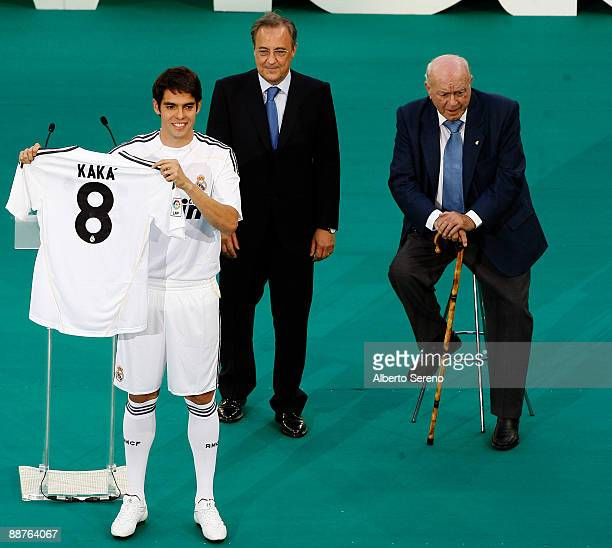 Real Madrid new player Kaka poses with his new tshirt during his official presentation as a Real Madrid player the President of Real Madrid...