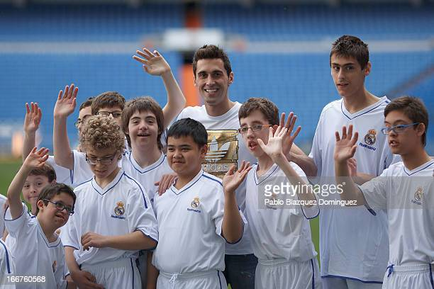 Real Madrid player Alvaro Arbeloa attends a trainning session with students of Real Madrid Foundation's inclusive football school at Estadio Santiago...