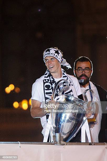 Real Madrid player Bale holds the trophy as he celebrates the victory In the UEFA Champions League Final match against Club Atletico de Madrid at...