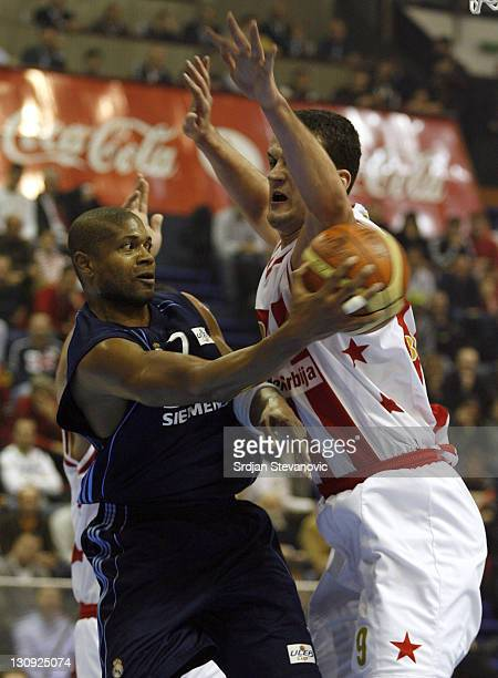 Real Madrid player Charles Smith left is challanged by Petar Popovic right from Red Star Belgrade during their quarter final ULEB Cup basketball...