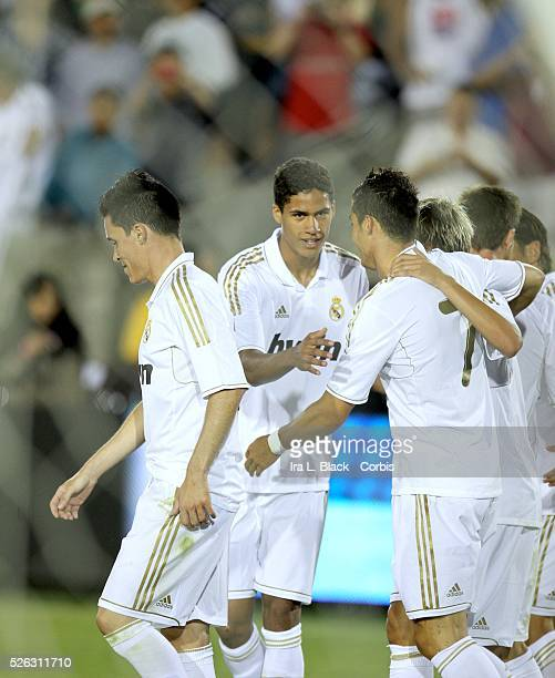 Real Madrid player Cristiano Ronaldo gets congratulated by teammates after his goal during to the Herbalife World Football Challenge Friendly match...