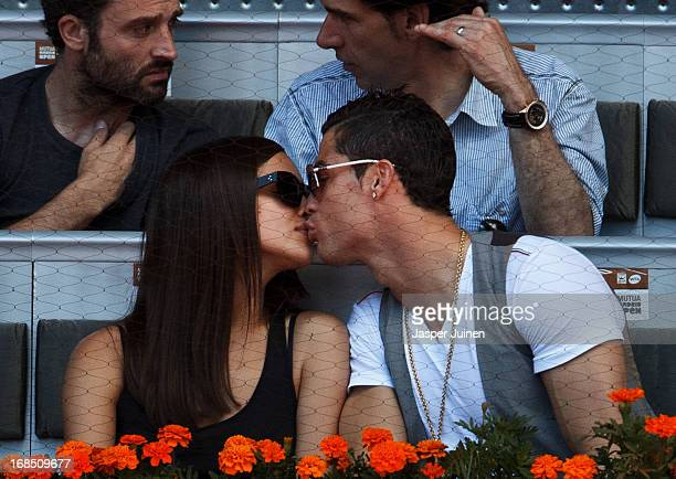 Real Madrid player Cristiano Ronaldo kisses his girlfriend Irina Shayk during the match between Rafael Nadal and David Ferrer of Spain on day seven...