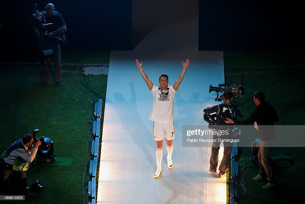 Real Madrid player <a gi-track='captionPersonalityLinkClicked' href=/galleries/search?phrase=Cristiano+Ronaldo+-+Soccer+Player&family=editorial&specificpeople=162689 ng-click='$event.stopPropagation()'>Cristiano Ronaldo</a> walks during the Real Madrid celebration the day after winning the UEFA Champions League final at Santiago Bernabeu Stadium on May 25, 2014 in Madrid, Spain. Real Madrid CF achieves their tenth European Cup at Lisbon at Lisbon 12 years later.