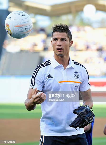Real Madrid player Cristiano Ronaldo warms up on the field before throwing out ceremonial first pitch before the game between the New York Yankees...