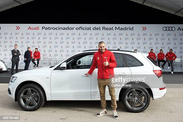 Real Madrid player Karim Benzema receives a new Audi car at the Ciudad Deportiva del Real Madrid on December 1 2014 in Madrid Spain