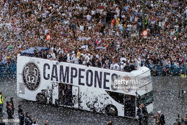 Real Madrid players arrive to Cibeles Square with thousands of fans for the celebration of the 12th Champions League title