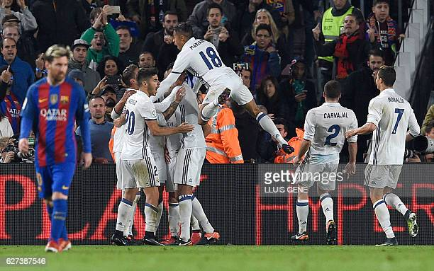 Real Madrid players celebrate a goal during the Spanish league football match FC Barcelona vs Real Madrid CF at the Camp Nou stadium in Barcelona on...