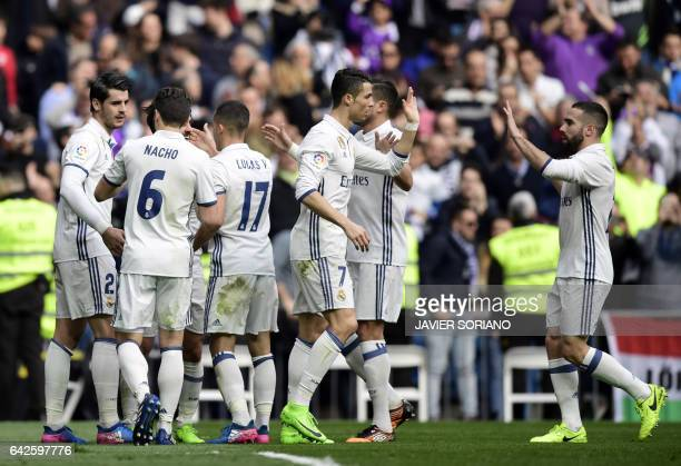 Real Madrid players celebrate a goal during the Spanish league football match Real Madrid CF vs RCD Espanyol at the Santiago Bernabeu stadium in...