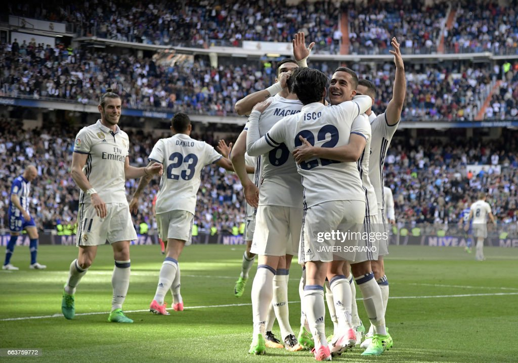 Real Madrid players celebrate a goal during the Spanish league football match Real Madrid CF vs Deportivo Alaves at the Santiago Bernabeu stadium in Madrid on April 2, 2017. /