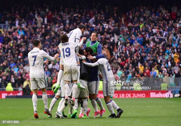 TOPSHOT Real Madrid players celebrate a goal during the Spanish league football match Real Madrid CF vs Valencia CF at the Santiago Bernabeu stadium...