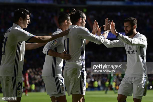Real Madrid players celebrate after scoring a goal during the Spanish league football match Real Madrid CF vs Club Deportivo Leganes SAD at the...