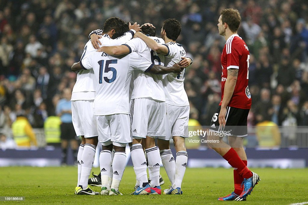 Real Madrid players celebrate after scoring during the Copa del Rey round of 16 second leg match between Real Madrid and Celta de Vigo at Estadio Santiago Bernabeu on January 9, 2013 in Madrid, Spain.