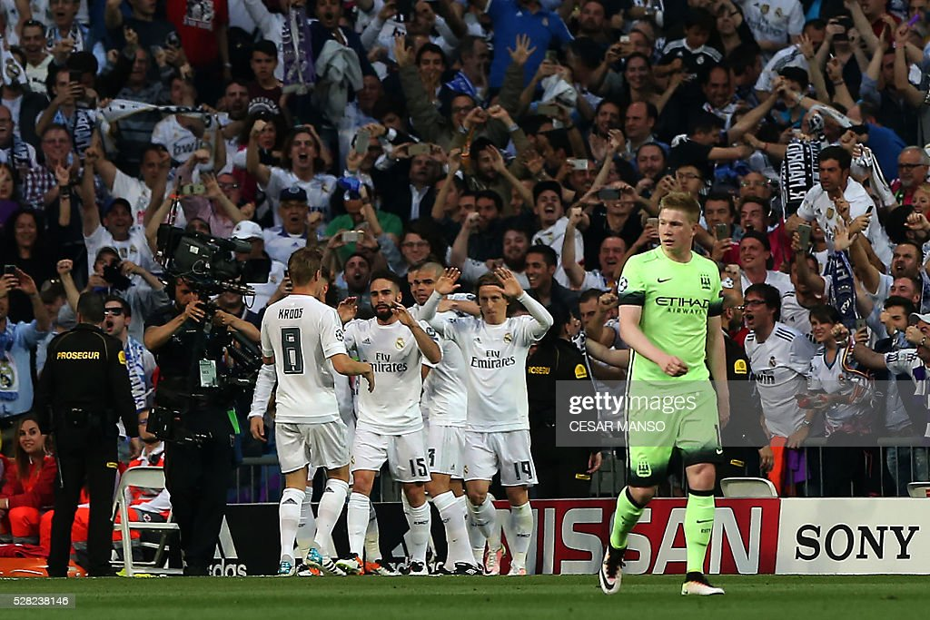 Real Madrid players celebrate after scoring during the UEFA Champions League semi-final second leg football match Real Madrid CF vs Manchester City FC at the Santiago Bernabeu stadium in Madrid, on May 4, 2016. / AFP / CESAR