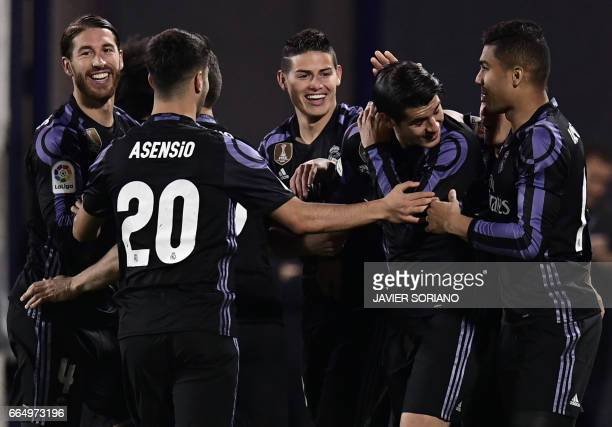 Real Madrid players celebrate after scoring their fourth goal during the Spanish league football match Club Deportivo Leganes SAD vs Real Madrid CF...