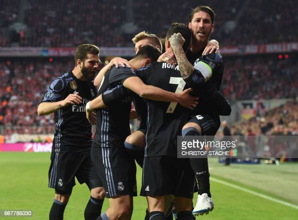Real Madrid' players celebrate after the second goal by Real Madrid's Portuguese forward Cristiano Ronaldo during the UEFA Champions League 1st leg...