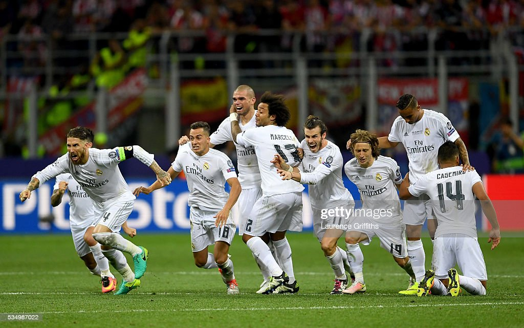 Real Madrid players celebrate after winning the penalty shoot out during the UEFA Champions League Final match between Real Madrid and Club Atletico de Madrid at Stadio Giuseppe Meazza on May 28, 2016 in Milan, Italy.