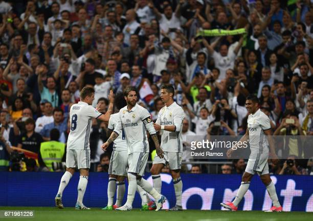 Real Madrid players celebrate as Casemiro of Real Madrid scores their first goal during the La Liga match between Real Madrid CF and FC Barcelona at...
