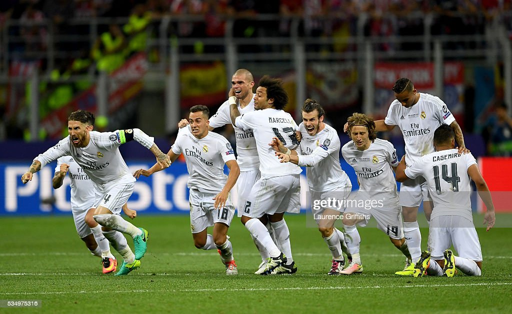 Real Madrid players celebrate celebrates after winning the Champions League Final after Cristiano Ronaldo scored the winning penalty in the penalty...