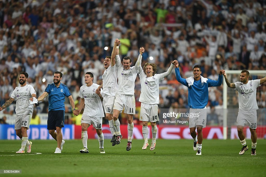 Real Madrid players celebrate following their team's 1-0 victory during the UEFA Champions League semi final, second leg match between Real Madrid and Manchester City FC at Estadio Santiago Bernabeu on May 4, 2016 in Madrid, Spain.