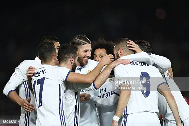 Real Madrid players celebrate the goal of Real Madrid forward Karim Benzema during the Club World Cup football final match between Kashima Antlers of...