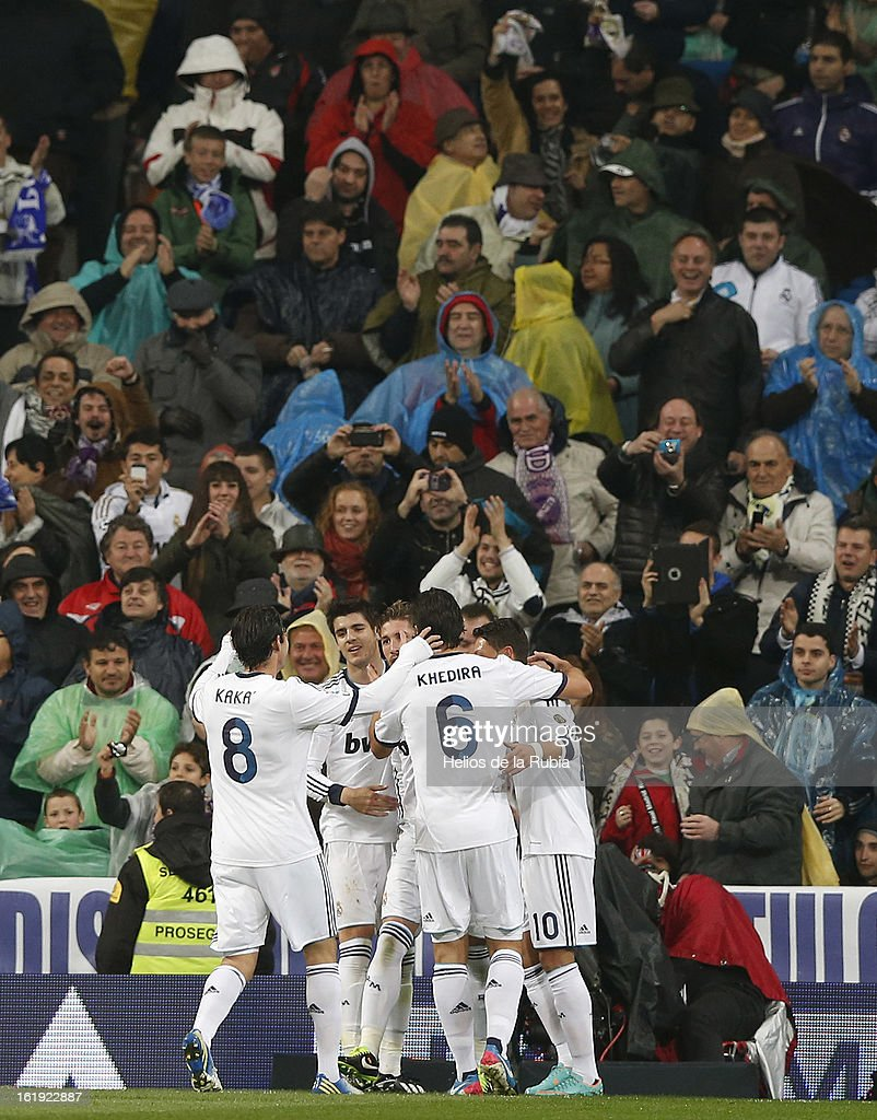 Real Madrid players celebrate the opening goal during the La Liga match between Real Madrid and Rayo Vallecano at Estadio Santiago Bernabeu on February 17, 2013 in Madrid, Spain.