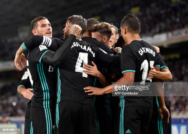 Real Madrid players celebrate their first goal during the Spanish league football match Real Sociedad vs Real Madrid CF at the Anoeta stadium in San...