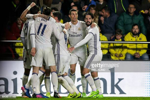 TOPSHOT Real Madrid players celebrate their goal during the Spanish League football match Villarreal CF vs Real Madrid at El Madrigal stadium in...