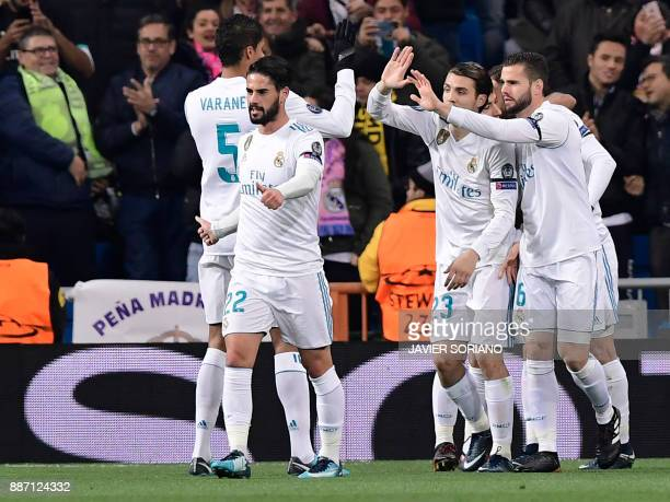 Real Madrid players celebrate their opening goal during the UEFA Champions League group H football match Real Madrid CF vs Borussia Dortmund at the...