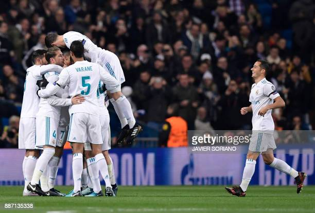 Real Madrid players celebrate their second goal during the UEFA Champions League group H football match Real Madrid CF vs Borussia Dortmund at the...