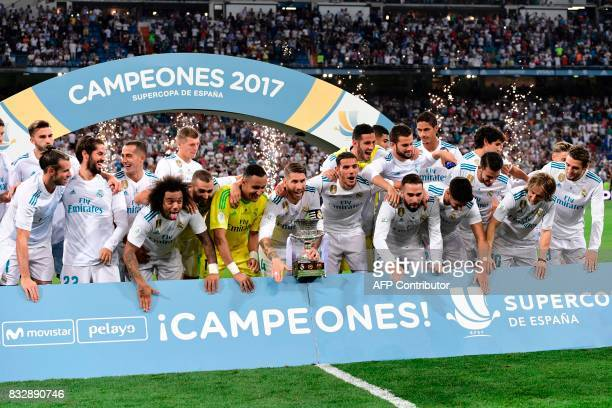 Real Madrid players celebrate their Supercup trophy after winning the second leg of the Spanish Supercup football match Real Madrid vs FC Barcelona...