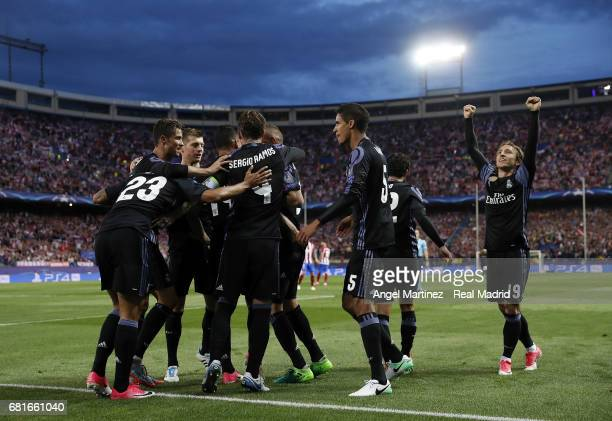 Real Madrid players celebrate their team's first goal during the UEFA Champions League Semi Final second leg match between Club Atletico de Madrid...