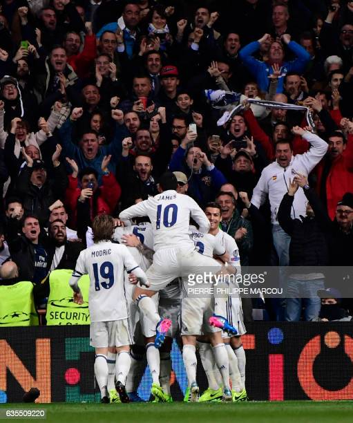 Real Madrid players celebrate their third goal during the UEFA Champions League round of 16 first leg football match Real Madrid CF vs SSC Napoli at...